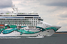 A colourful hull brightens an otherwise dull day as Norwegian Jade dep...