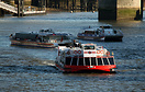 Even in winter the River Thames is bustling with tourist boats. Here M...