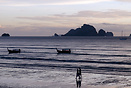 Longtails moored off Ao Nang beach at sunset.