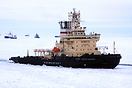 Busy icebreaker Sankt-Peterburg assisting the vessels in the Gulf Of F...