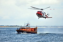 Calshot lifeboat on exercise with the coastguard helicopter off Calsho...